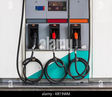Three refuel nozzles in gas station - Stock Photo