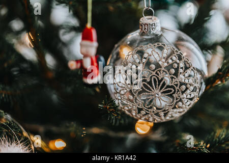 Close-up of baubles and decorations hanging on a Christmas tree - Stock Photo
