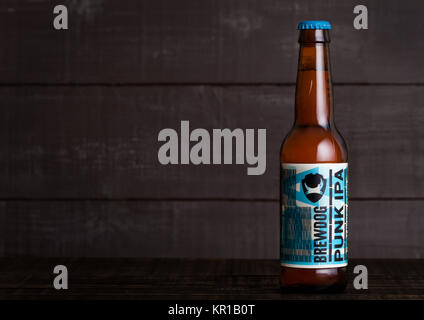 LONDON, UK - DECEMBER 15, 2017: Bottle of Punk Ipa post modern classic, from the Brewdog brewery on wooden background. - Stock Photo