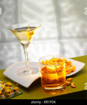 Two drinks with peanuts and olives - Stock Photo