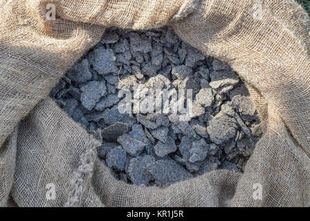 Pressed pressure of sunflower seeds in a bag. sunflower oil production waste. - Stock Photo