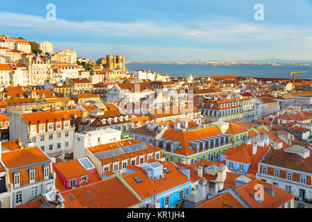 Skyline of Lisbon with famous Lisbon Cathedral at sunset. Portugal - Stock Photo