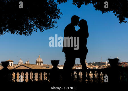 Silhouette couple kissing in Rome Italy - Stock Photo