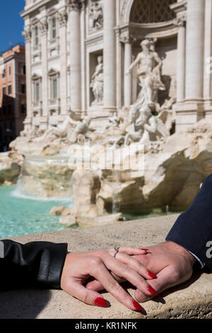 Couple holding hands just engaged in Rome Italy - Stock Photo