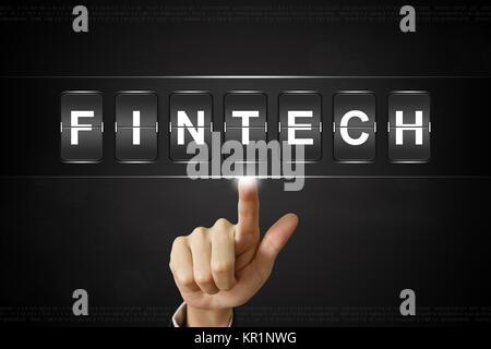 business hand clicking fintech or financial technology on Flipboard - Stock Photo