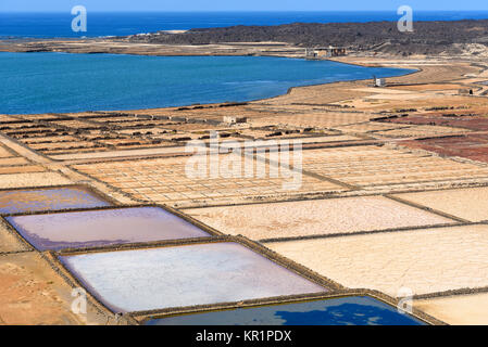 salt works Salinas de Janubio in Lanzarote, Canary islands, Spain - Stock Photo