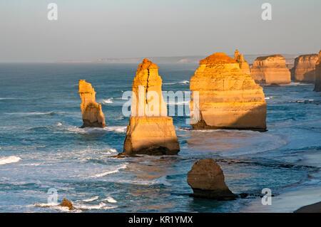Sunrise over Twelves Apostles in Great Ocean Road, Victoria, Australia. The Twelve Apostles is a collection of limestone - Stock Photo