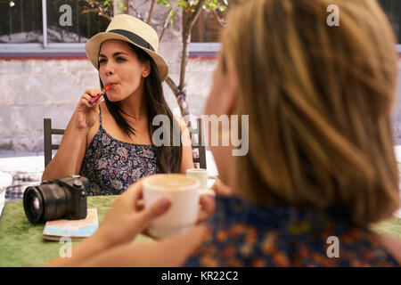 Woman Smoking Electronic Cigarette Drinking Coffee In Bar - Stock Photo