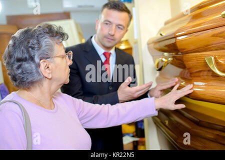 choosing a coffin - Stock Photo