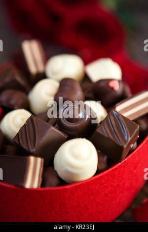 chocolate pralines in heart shaped gift box background- Mother's Day - Stock Photo