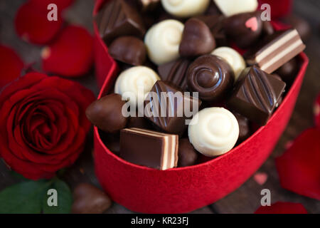 Chocolate pralines in gift box on wooden for Mother's Day background - Stock Photo