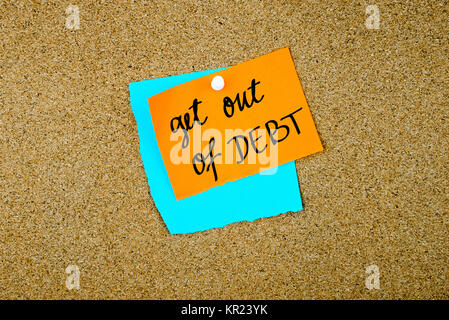 Get Out Of Debt written on paper notes - Stock Photo