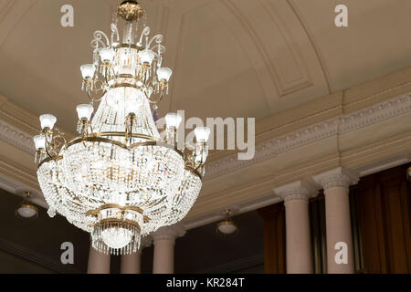 A huge chandelier in the concert hall - Stock Photo
