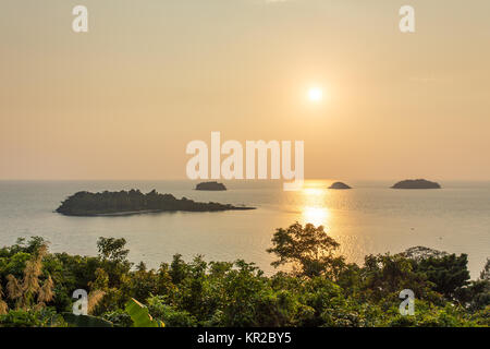 Beautiful tropical island landscape. View from Koh Chang to Koh Man Nai during sunset - Stock Photo