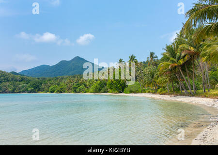 Beautiful tropical beach with palm trees on Koh Chang island in Thailand - Stock Photo