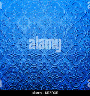 blue color glass with thai pattern - Stock Photo