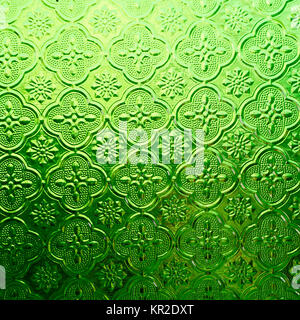 green color glass with thai pattern - Stock Photo