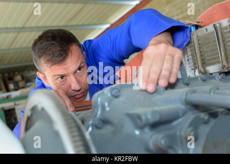 checking on the motor - Stock Photo