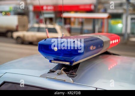 The roof-mounted lightbar of police car - Stock Photo
