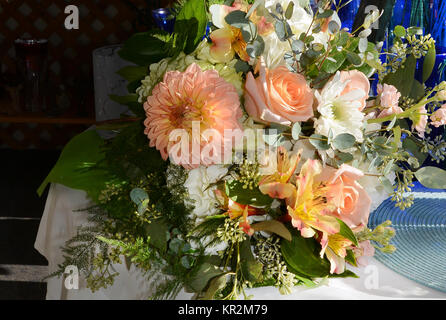 Photo of a sunny bridal bouquet filled with dahlias, roses, alstroemeria, green hydrangea, mums, stock and eucalyptus. - Stock Photo