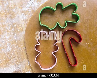 plastic cookie cutter on gingerbread dough - Stock Photo