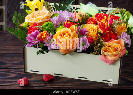 Valentine's Day or greeting card. Beautiful bouquet of flowers as a gift on a vintage wooden background. - Stock Photo