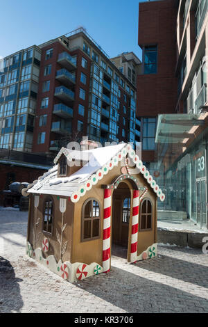 A small warming hut in the style of a gingerbread house set up for children during the Christmas season in Toronto's - Stock Photo