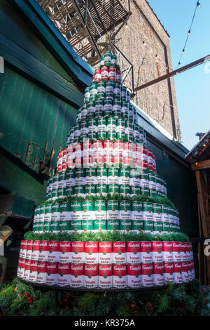 An stack of Campbell soup cans arranged to represent a Christmas tree at the Christmas market in Toronto's historic - Stock Photo