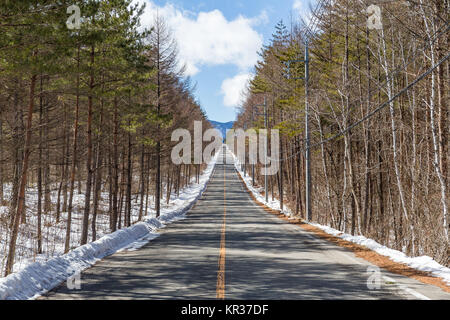 Winter road with clear blue sky - Stock Photo