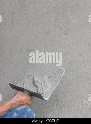 Builder worker plastering concrete - Stock Photo
