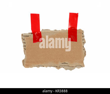 old isolated cardboard with red tape - Stock Photo