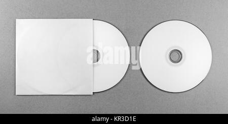 Blank CD on gray - Stock Photo