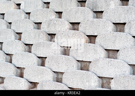 Close up patterns and textures of curved interlocking concrete retaining wall bricks - Stock Photo