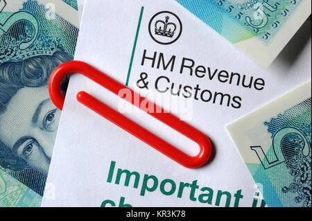 HMRC INLAND REVENUE LETTER WITH NEW FIVE POUND NOTES AND PAPER CLIP RE TAX H M REVENUE AND CUSTOMS TAXES INCOMES - Stock Photo