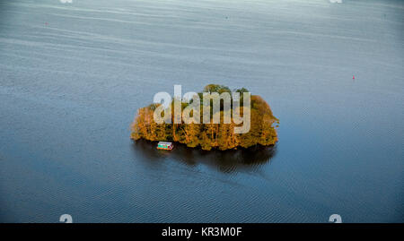 The Muritz with heart-shaped island and residential boat and pleasure boat in the sunset, Vipperow, Mecklenburg - Stock Photo