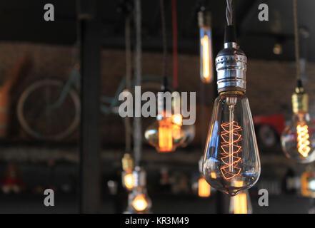 Decorative light bulbs on beautiful background - Stock Photo