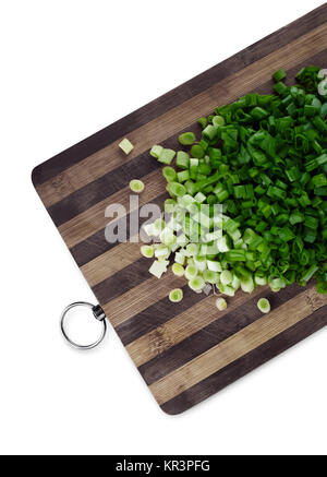Green chopped onions on a cutting board - Stock Photo