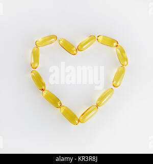 Pills in heart shape - Stock Photo