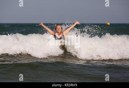 Woman has sent a wave. - Stock Photo