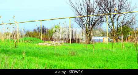 Gas pipe on the background of grass - Stock Photo