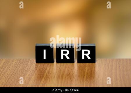 IRR or Internal Rate Of Return on black block - Stock Photo