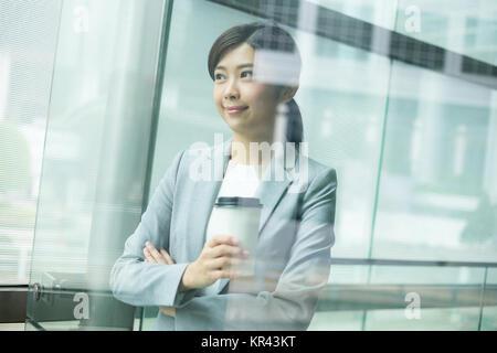 Asian businesswoman inside office - Stock Photo
