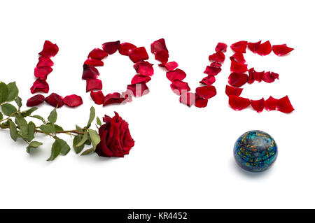 inscription love from petals of roses, and one rose at the left and on the right the globe, isolate - Stock Photo