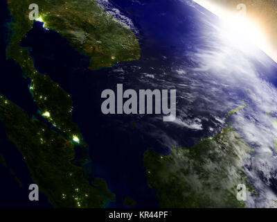 Malaysia from space during sunrise - Stock Photo