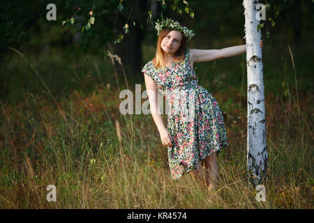 Girl with a wreath on his head - Stock Photo