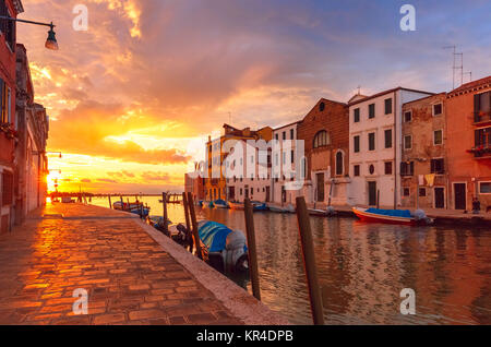 Sunset on canal Cannaregio in Venice, Italy - Stock Photo