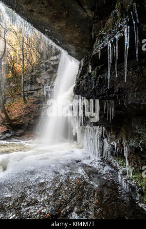 Gibson's Cave and a Partly Frozen Summerhill Force, Bowlees, Upper Teesdale, County Durham UK. - Stock Photo