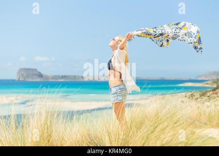 Free Happy Woman Enjoying Sun on Vacations. - Stock Photo