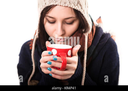 Winter girl drinking tea or coffee to wake up. Lifestyle studio photo isolated portrait of a woman on a white background. - Stock Photo