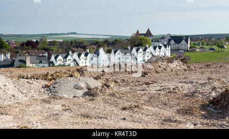 Dorchester, England, UK - May 7, 2016 - Completed streets of houses and construction earthworks in Poundbury, Prince - Stock Photo